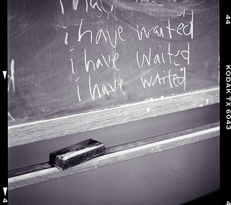 "Kodak-framed photo of five lines of messy ""i have waited"" sentences"
