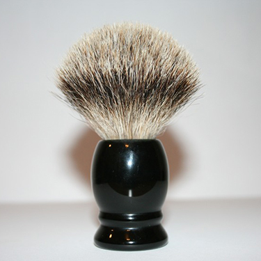 Man's black-handled shaving brush
