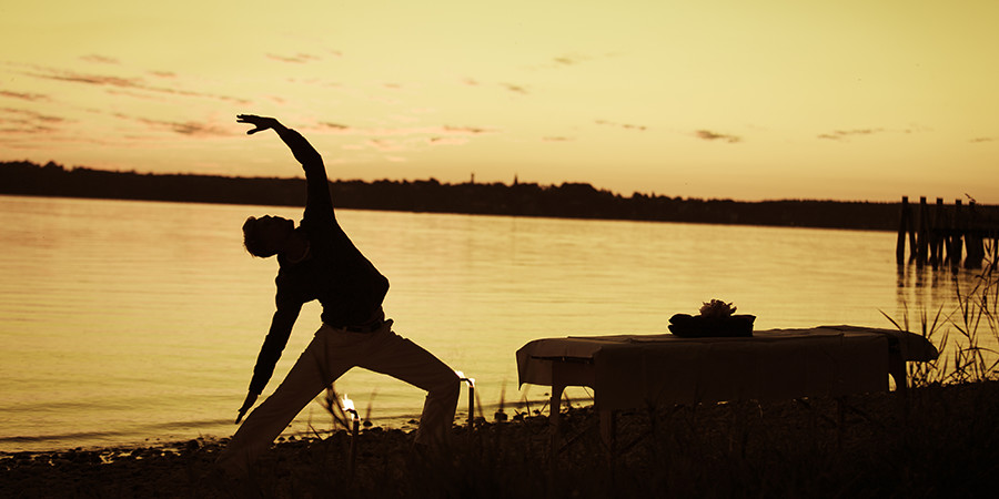 Golden sunset reverse warrior yoga pose